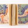 "Voltaire, Candide, illustrated by Raoul Serres, 1947.  Full leather binding, endpapers with leather joint.  18 x 23 cm (7"" x 9"")."